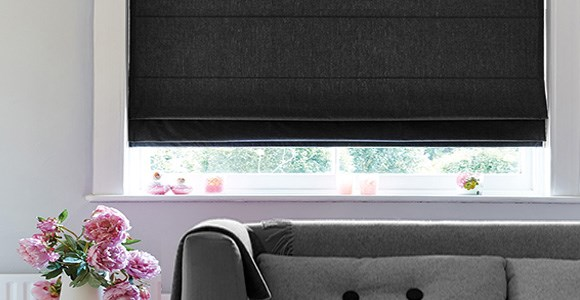 Classic black roman blinds in a variety of chic textures and practical fabrics