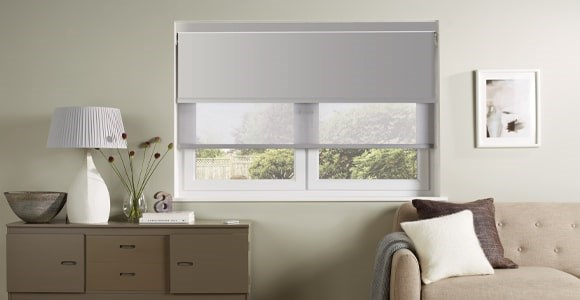 The ultimate in practical window dressings. Blackout and screen roller blinds on a single window.