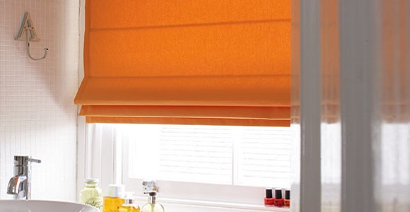 A collection of beautiful orange roman blinds, handmade in a variety of textures in our UK factory
