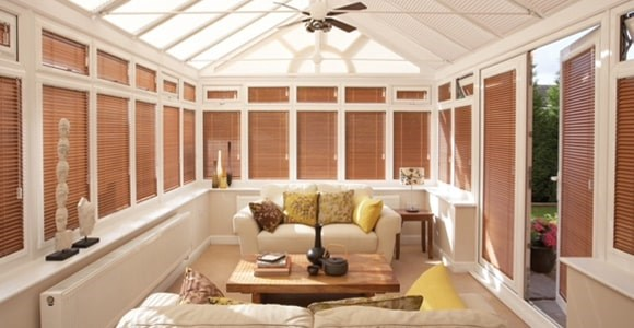 Perfect fit wood blinds are an ideal solution for creating a warming but functional finish.