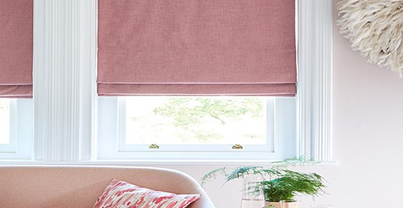 A stylish collection of on trend pink roman blinds, handmade in a variety of fabrics