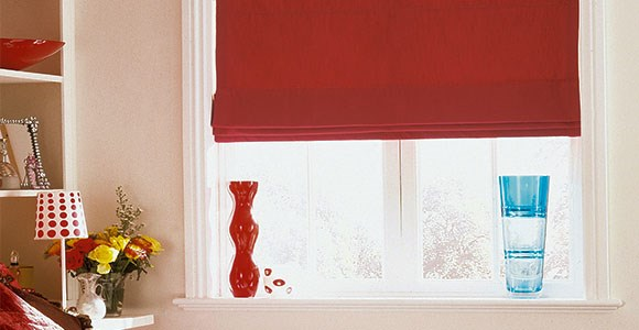 Stylish red roman blinds in a selection of textures, handmade with care in our Midlands factory