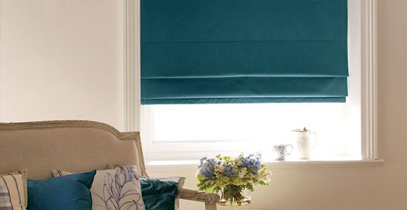 A collection of chic teal roman blinds in a variety of beautiful fabric textures and opacities